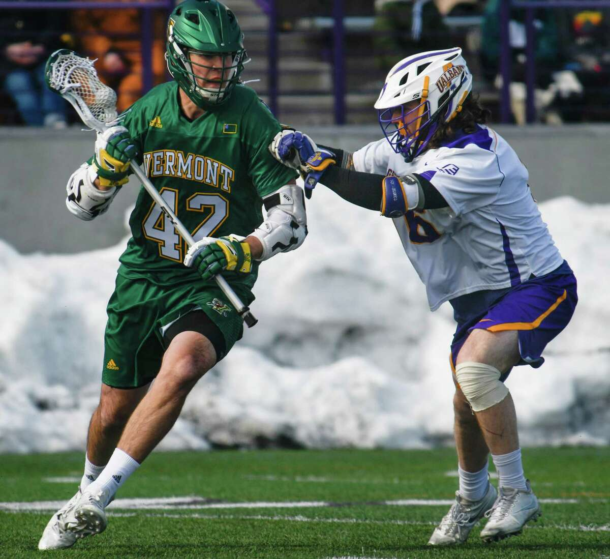 UAlbany's Nate Siekierski pushes Vermont's Dawes Milchling during a game at Casey Stadium on Saturday, Mar. 17, 2018, in Albany, N.Y. (Jenn March, Special to the Times Union)