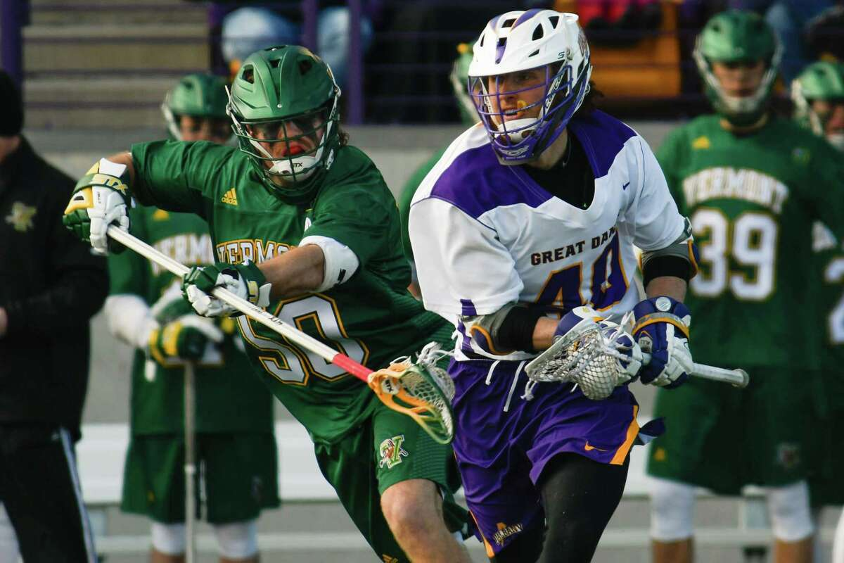 Vermont's James Leary stick checks UAlbany's AJ Kluck as he drives with the ball during a game at Casey Stadium on Saturday, Mar. 17, 2018, in Albany, N.Y. (Jenn March, Special to the Times Union)