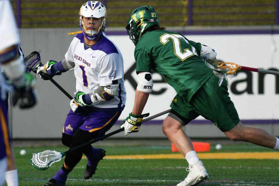 UAlbany's Tehoka Nanticoke looks to pass the ball as Vermont's Warren Jeffrey defends during a game at Casey Stadium on Saturday, Mar. 17, 2018, in Albany, N.Y. (Jenn March, Special to the Times Union) Photo: Jenn March / © Jenn March 2018 © Albany Times Union 2018