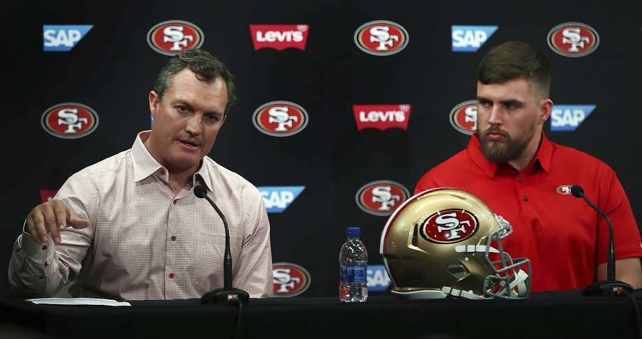 San Francisco 49ers general manager John Lynch, left, gestures beside newly signed player Weston Richburg during a news conference Thursday, March 15, 2018, in Santa Clara, Calif. Photo: Ben Margot, Associated Press