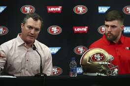 San Francisco 49ers general manager John Lynch, left, gestures beside newly signed player Weston Richburg during a news conference Thursday, March 15, 2018, in Santa Clara, Calif. (AP Photo/Ben Margot)