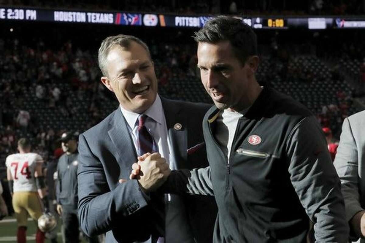 HOUSTON, TX - DECEMBER 10: Head coach Kyle Shanahan of the San Francisco 49ers celebrates with general manager John Lynch after the game against the Houston Texans at NRG Stadium on December 10, 2017 in Houston, Texas. ~~