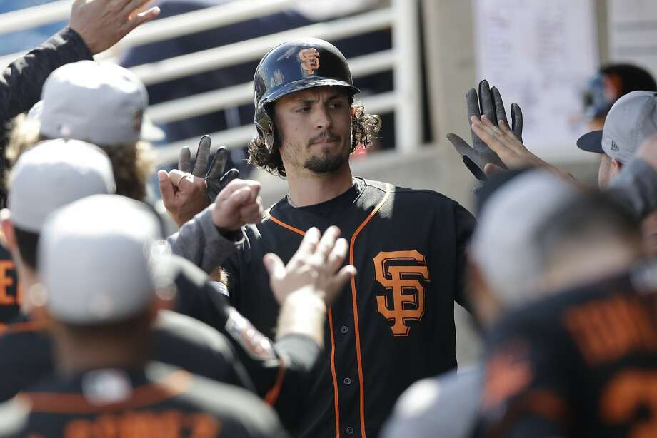 Jarrett Parker accepts congratulations from Giants teammates after an early-spring home run. Photo: Carlos Osorio, Associated Press