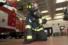 "Bridgeport firefighter Justin Fontan takes part in a ""mayday"" drill at fire headquarters in Bridgeport, Conn. March 9, 2018. During the drill, firefighters dressed in full protective gear learn to communicate their condition and location via a radio in their breathing apparatus in the event they become stranded or incapacitated during an emergency situation."