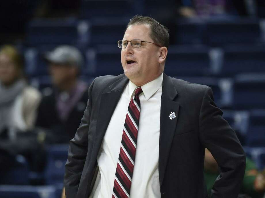 """St. Francis coach Joe Haigh said, """"Nobody else in the world stopped (UConn), so we were going to try to outscore them"""" in Saturday's first-round NCAA Tournament game. Photo: Brad Horrigan / TNS / Hartford Courant"""