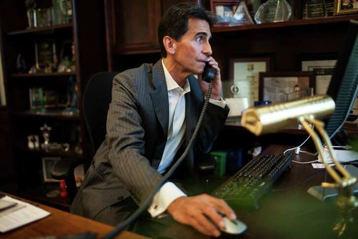 Mark Leno, then a state senator, takes a phone call in his state Capitol office in Sacramento in 2014.