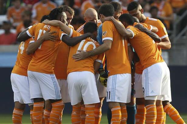 Houston Dynamo players huddle before taking on the Vancouver Whitecaps during the first half of the MLS game at BBVA Compass Stadium on Saturday, March 10, 2018, in Houston. ( Yi-Chin Lee / Houston Chronicle )