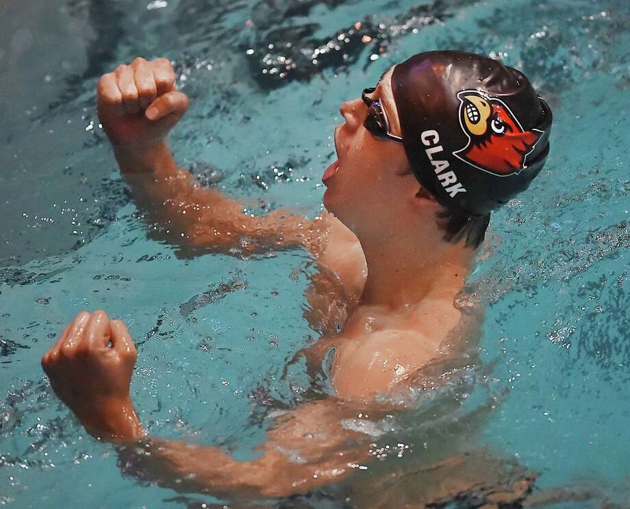 Greenwich sophomore Charles Clark pumps his fist at the end of the 400 yard freestyle pulling ahead of Pomperaug and solidifying their 30.5 point win over Fairfield Prep as the CIAC state open boys swimming champion, March 17, 2018, at Kiputh Pool at Yale University in New Haven. Greenwich won with a total of 487.5 points, finishing second, Fairfield Prep with 457 points. Photo: Catherine Avalone, Hearst Connecticut Media / New Haven Register
