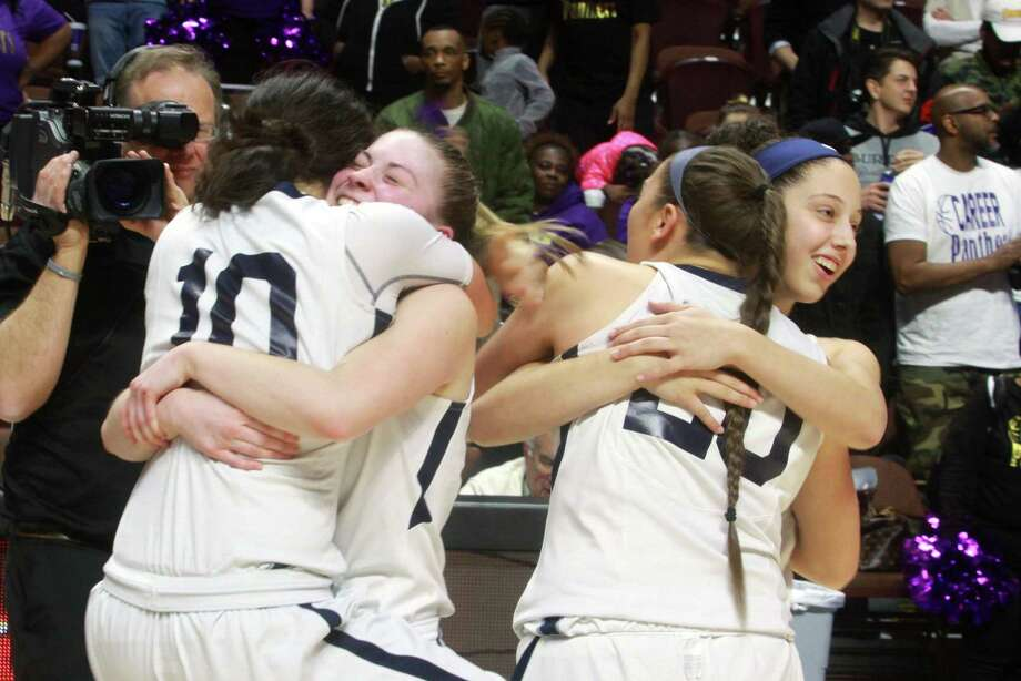 East Haven celebrates its win over Career in the Class M championship game on Saturday in Montville. Photo: Christian Abraham / Hearst Connecticut Media / Connecticut Post