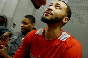 Houston' Galen Robinson Jr. talks to the media in the locker room after practice at the NCAA men's college basketball tournament, Friday, March 16, 2018, in Wichita, Kan. Kan. Houston faces Michigan in the second round on Saturday. (AP Photo/Charlie Riedel)