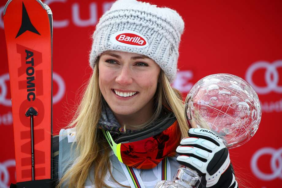 Mikaela Shiffrin celebrates anothert trophy at the World Cup finals in Are, Sweden. Photo: Marco Trovati, Associated Press