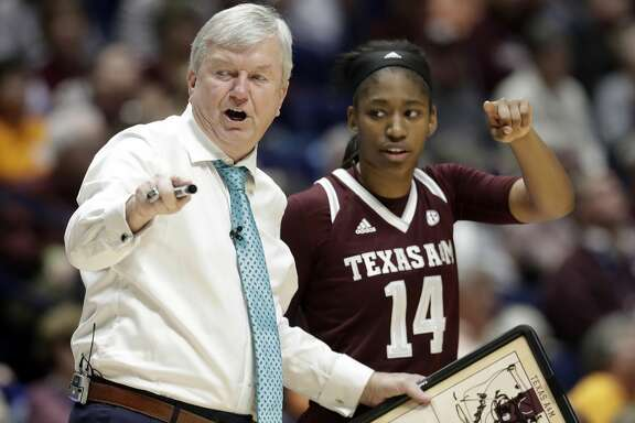 Texas A&M head coach Gary Blair talks to guard Jada Walton (14) in the second half of an NCAA college basketball game against LSU at the women's Southeastern Conference tournament Friday, March 2, 2018, in Nashville, Tenn. Texas A&M won 75-69. (AP Photo/Mark Humphrey)