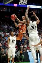 Texas guard Matt Coleman, left, had a career-best game against Nevada with 25 points on 9-of-15 shooting plus four assists.