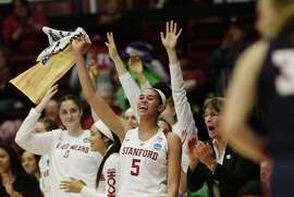 Stanford's Kaylee Johnson (5) and bench cheers as Stanford scores against Gonzaga in the second quarter at Maples Pavilion on Saturday, March 17, 2018, in Stanford, Calif.