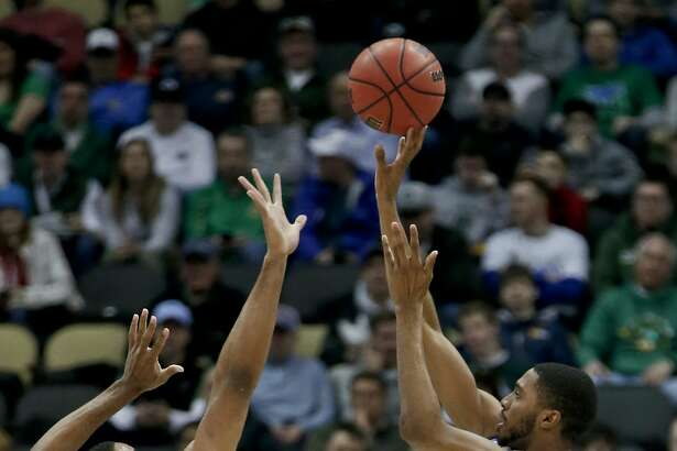 Villanova's Mikal Bridges (25) shoots over Alabama's Galin Smith (30) during the first half of a second-round game in the NCAA men's college basketball tournament, Saturday, March 17, 2018, in Pittsburgh. (AP Photo/Keith Srakocic)