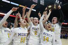 Mercy celebrates its win over Hall in Class LL Girls Basketball Championship action at Mohegan Sun Arena in Montville, Conn., on Saturday Mar. 17, 2018.
