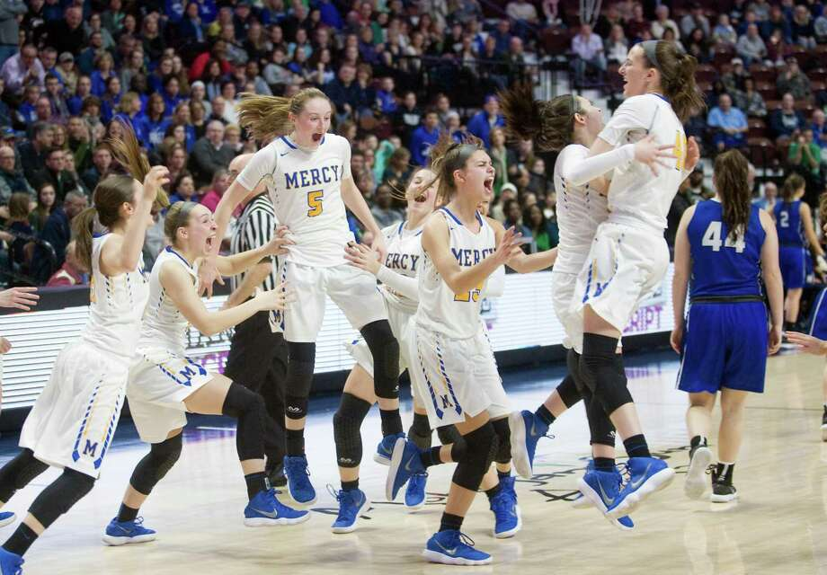 Mercy celebrates its win over Hall in the Class LL championship game at Mohegan Sun Arena on Saturday. Photo: Christian Abraham / Hearst Connecticut Media / Connecticut Post