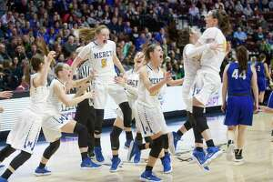 Mercy celebrates its win over Hall in the Class LL championship game at Mohegan Sun Arena on Saturday.