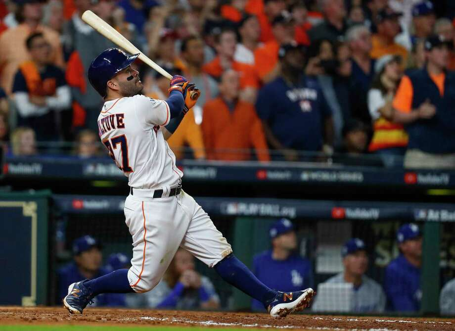 Jose Altuve, swatting a three-run homer in Game 5 of the World Series, could have commanded more than his $163 million on the free-agent market. Photo: Karen Warren, Staff / © 2017 Houston Chronicle