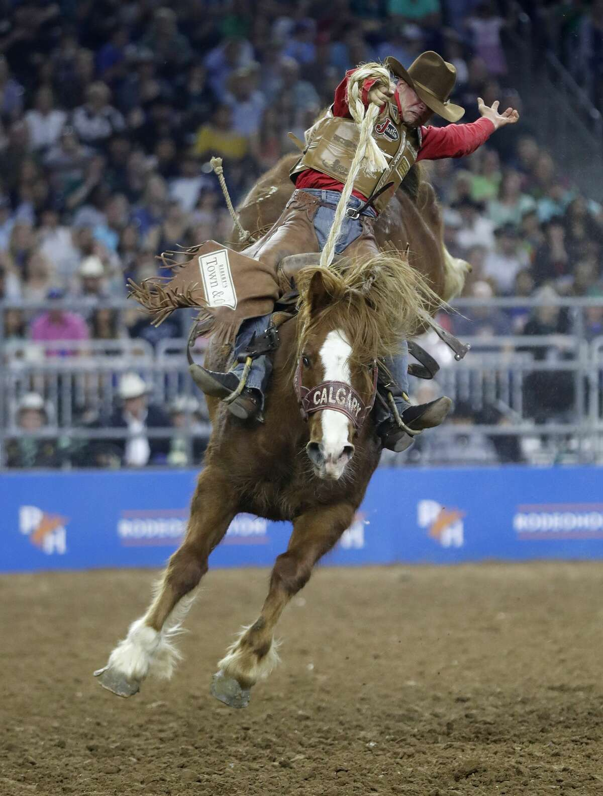 Cody DeMoss scores a 92.0 on his Saddle Bronc ride during the Super Series Championship at the Houston Livestock Show and Rodeo at NRG Stadium, Saturday, March 17, 2018, in Houston. ( Karen Warren / Houston Chronicle )