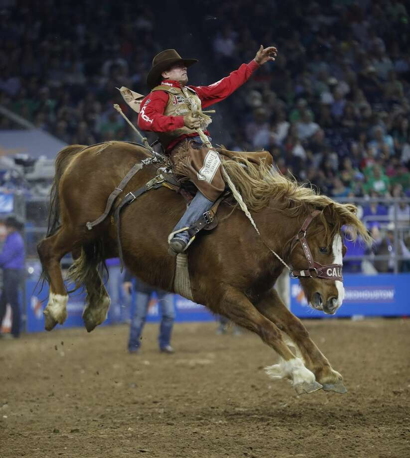 Cody DeMoss scores a 92.0 on his Saddle Bronc ride during the Super Series Championship at the Houston Livestock Show and Rodeo at NRG Stadium, Saturday, March 17, 2018, in Houston.  ( Karen Warren / Houston Chronicle ) Photo: Karen Warren/Houston Chronicle