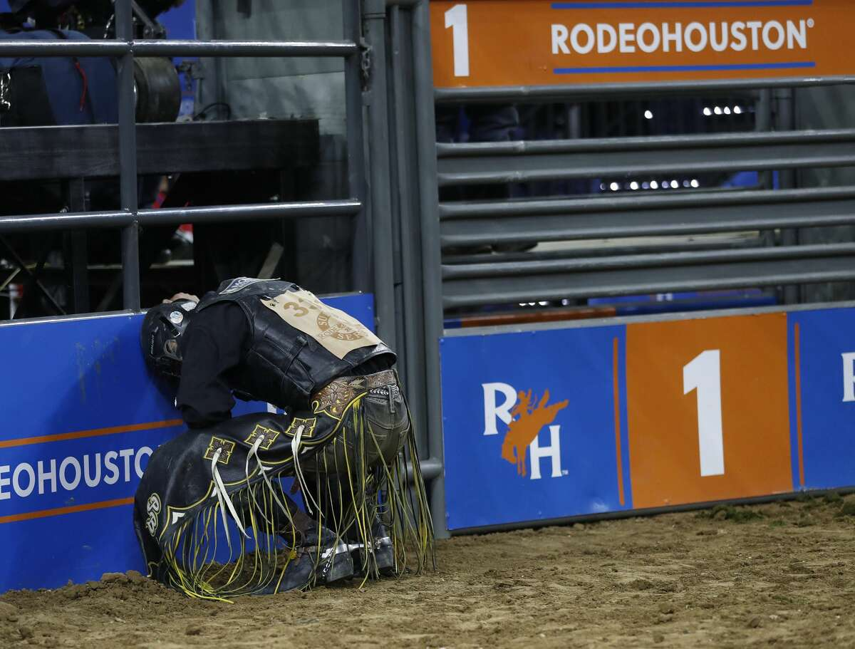 Parker Breding reacts after getting bucked off a bull during a tie-off against JW Harris, however Breding went on to win the Bull Riding Championship during the Super Series Championship at the Houston Livestock Show and Rodeo at NRG Stadium, Saturday, March 17, 2018, in Houston. ( Karen Warren / Houston Chronicle )