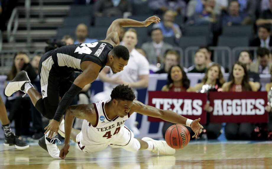 Texas A&M forward Robert Williams, bottom, will have to be strong at both ends of the court if the Aggies are to have any chance of upsetting North Carolina and reaching the Sweet 16. Photo: Streeter Lecka, Staff / 2018 Getty Images