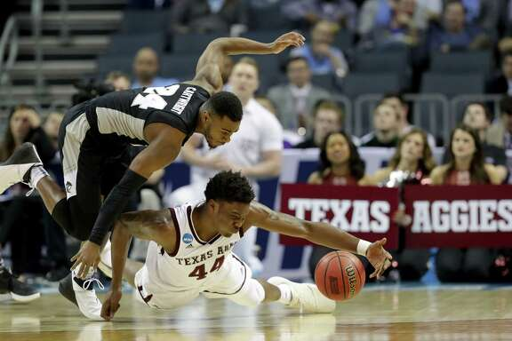 Texas A&M forward Robert Williams, bottom, will have to be strong at both ends of the court if the Aggies are to have any chance of upsetting North Carolina and reaching the Sweet 16.