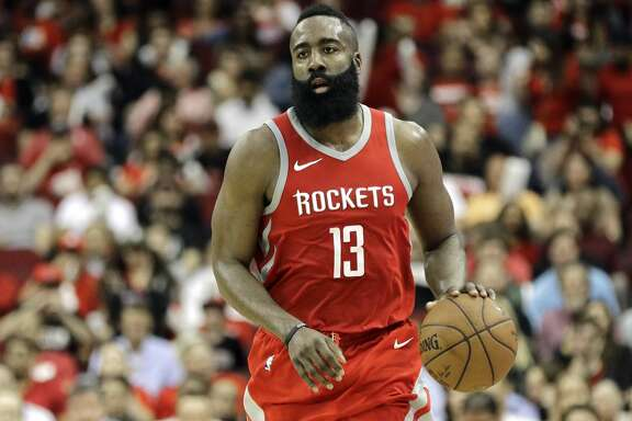 Houston Rockets' James Harden (13) brings the ball up court against the LA Clippers during the second half of an NBA basketball game Thursday, March 15, 2018, in Houston. The Rockets won 101-96. (AP Photo/David J. Phillip)