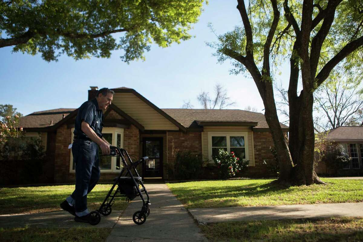 Gail Bullock, 77, takes his therapeutic walk by his home trying to recuperate from surgery. Bullock's home which is located upstream of Addicks Reservoir took on two feet of water after Hurricane Harvey struck the area. Monday, March 12, 2018.