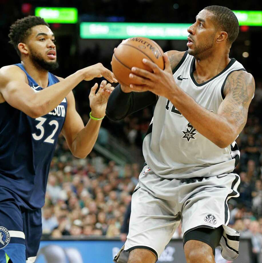 San Antonio Spurs' LaMarcus Aldridge looks for room around Minnesota TimberwolvesÕ Karl-Anthony Towns during first half action Saturday March 17, 2018 at the AT&T Center. Photo: Edward A. Ornelas, San Antonio Express-News / © 2018 San Antonio Express-News