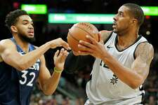 San Antonio Spurs' LaMarcus Aldridge looks for room around Minnesota TimberwolvesÕ Karl-Anthony Towns during first half action Saturday March 17, 2018 at the AT&T Center.