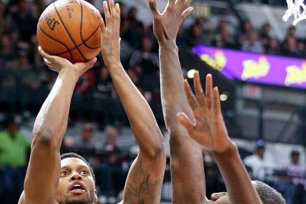 San Antonio SpursÕ Rudy Gay shoots around Minnesota TimberwolvesÕ Gorgui Dieng during first half action Saturday March 17, 2018 at the AT&T Center.