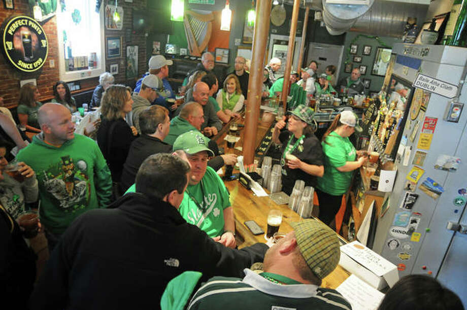 The standing-room-only St. Patrick's Day crowd inside Morrison's Irish Pub. Photo: David Blanchette | For The Telegraph