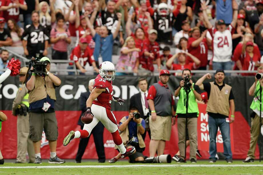 Free safety Tyrann Mathieu, who converted an interception into a touchdown for the Cardinals, will bring his considerable skills to the Texans. Photo: Christian Petersen, Staff / 2015 Getty Images