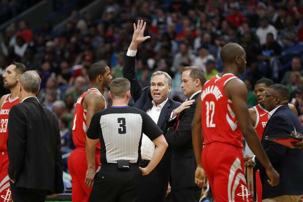 Houston Rockets head coach Mike D'Antoni challenges an official in the first half of an NBA basketball game against the New Orleans Pelicans in New Orleans, Saturday, March 17, 2018. (AP Photo/Gerald Herbert)