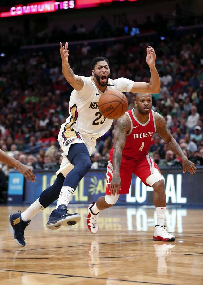 New Orleans Pelicans forward Anthony Davis (23) loses the ball driving to the basket against Houston Rockets forward PJ Tucker (4) in the second half of an NBA basketball game in New Orleans, Saturday, March 17, 2018. The Rockets won 107-101. (AP Photo/Gerald Herbert) Photo: Gerald Herbert/Associated Press