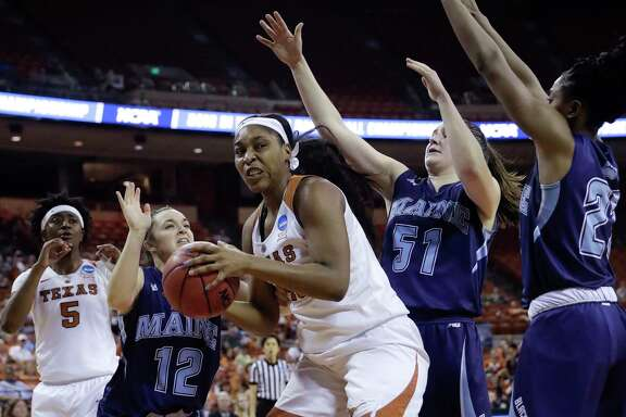 Texas forward Jatarie White, left, proves too much to handle for Maine's defense, finishing with a game-high 17 points.