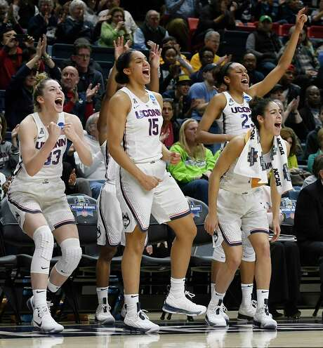 From left, Connecticut starters Katie Lou Samuelson, Gabby Williams, Kia Nurse and Azura Stevens cheer on the reserves after taking a seat during the second half of the Huskies' rout Saturday. Photo: Jessica Hill, FRE / AP2018