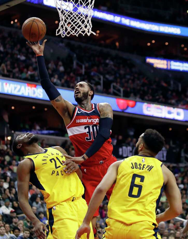 Washington Wizards forward Mike Scott (30) shoots between Indiana Pacers forward Thaddeus Young (21) and guard Cory Joseph (6) during the second half of an NBA basketball game Saturday, March 17, 2018, in Washington. The Wizards won 109-102. (AP Photo/Alex Brandon) Photo: Alex Brandon, STF / Copyright 2018 The Associated Press. All rights reserved.