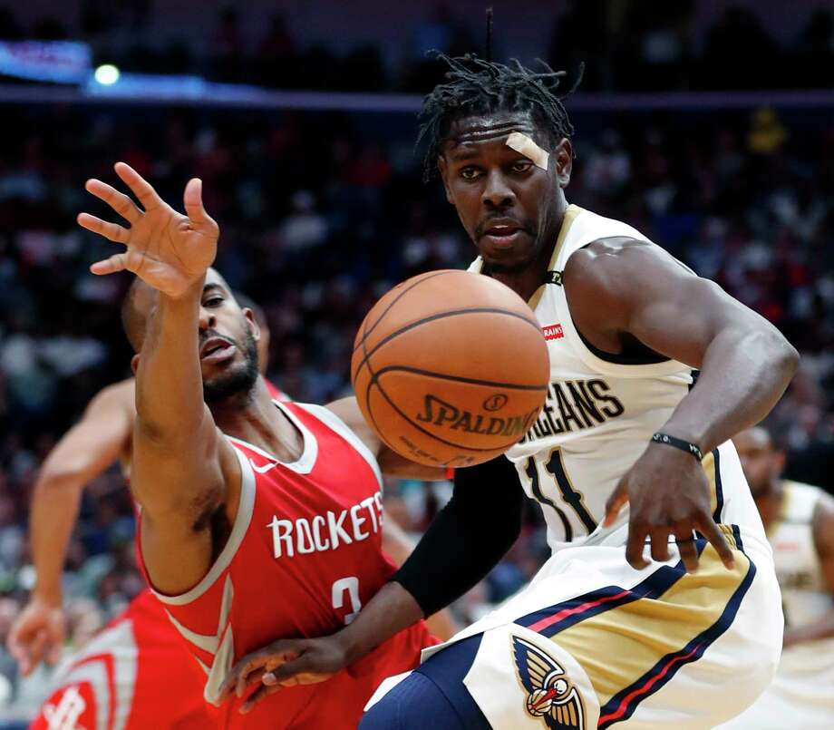 Pelicans guard Jrue Holiday, right, and Rockets guard Chris Paul battle for possession of the ball during the second half Saturday night in New Orleans. Photo: Gerald Herbert, STF / Copyright 2018 The Associated Press. All rights reserved.