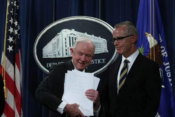 "(FILES) In this file photo taken on July 12, 2017,  US Attorney General Jeff Sessions (L) picks up his remarks as Acting FBI Director Andrew McCabe (R) looks on during a news conference to announce significant law enforcement actions  at the Justice Department in Washington, DC.  Former deputy FBI director Andrew McCabe has been fired for misconduct, the attorney general said March 16, 2018, just days before he would have been eligible for full retirement benefits. ""I have terminated the employment of Andrew McCabe effective immediately,"" Jeff Sessions said in a statement. / AFP PHOTO / ALEX WONGALEX WONG/AFP/Getty Images"