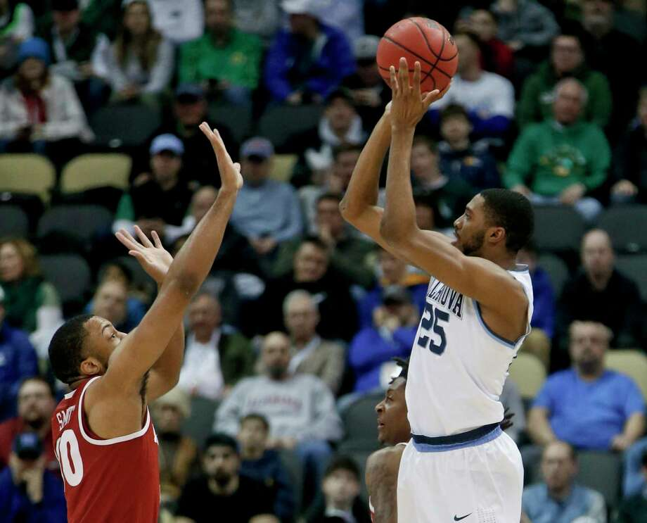 Villanova's Mikal Bridges, right, shoots over Alabama's Galin Smith during Saturday's second-round matchup. Bridges had five of the Wildcats' 17 3-pointers and led the way with 23 points. Photo: Keith Srakocic, STF / Copyright 2018 The Associated Press. All rights reserved.