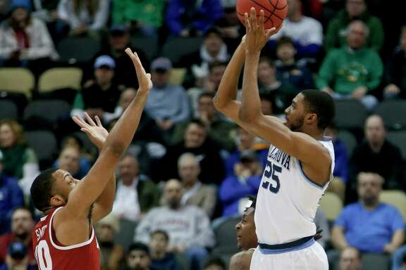 Villanova's Mikal Bridges, right, shoots over Alabama's Galin Smith during Saturday's second-round matchup. Bridges had five of the Wildcats' 17 3-pointers and led the way with 23 points.