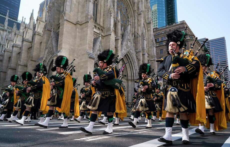 Bagpipers with the NYPD Emerald Society walks past St. Patrick's Cathedral as they take part in the St. Patrick's Day parade Saturday, March 17, 2018, in New York.  Irish Prime Minister Leo Varadkar joined along as Manhattan's Fifth Avenue came alive with the sound of bagpipes, trumpets and lots of green during the 257th running of the parade.  (AP Photo/Craig Ruttle) Photo: Craig Ruttle / FR61802 AP