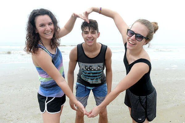 Hannah Schultz, Jonah Romero and Larissa Theriac were at Crystal Beach on the last weekend of spring break for many area students and families. Photo taken Saturday, March 17, 2018 Kim Brent/The Enterprise