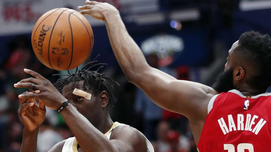 New Orleans Pelicans guard Jrue Holiday (11) loses the ball as he tries to goes to the basket between Houston Rockets guard James Harden (13) and center Clint Capela (15) during the second half of an NBA basketball game in New Orleans, Saturday, March 17, 2018. The Rockets won 107-101. (AP Photo/Gerald Herbert) Photo: Gerald Herbert/Associated Press