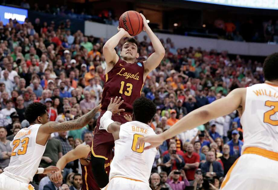 Loyola-Chicago guard Clayton Custer (13) shoots over Tennessee's Jordan Bowden (23) and Jordan Bone (0) and scores in the final seconds of a second-round game at the NCAA men's college basketball tournament in Dallas, Saturday, March 17, 2018. The shot helped Loyola to a 63-62 win. (AP Photo/Tony Gutierrez) Photo: Tony Gutierrez / Copyright 2018 The Associated Press. All rights reserved.