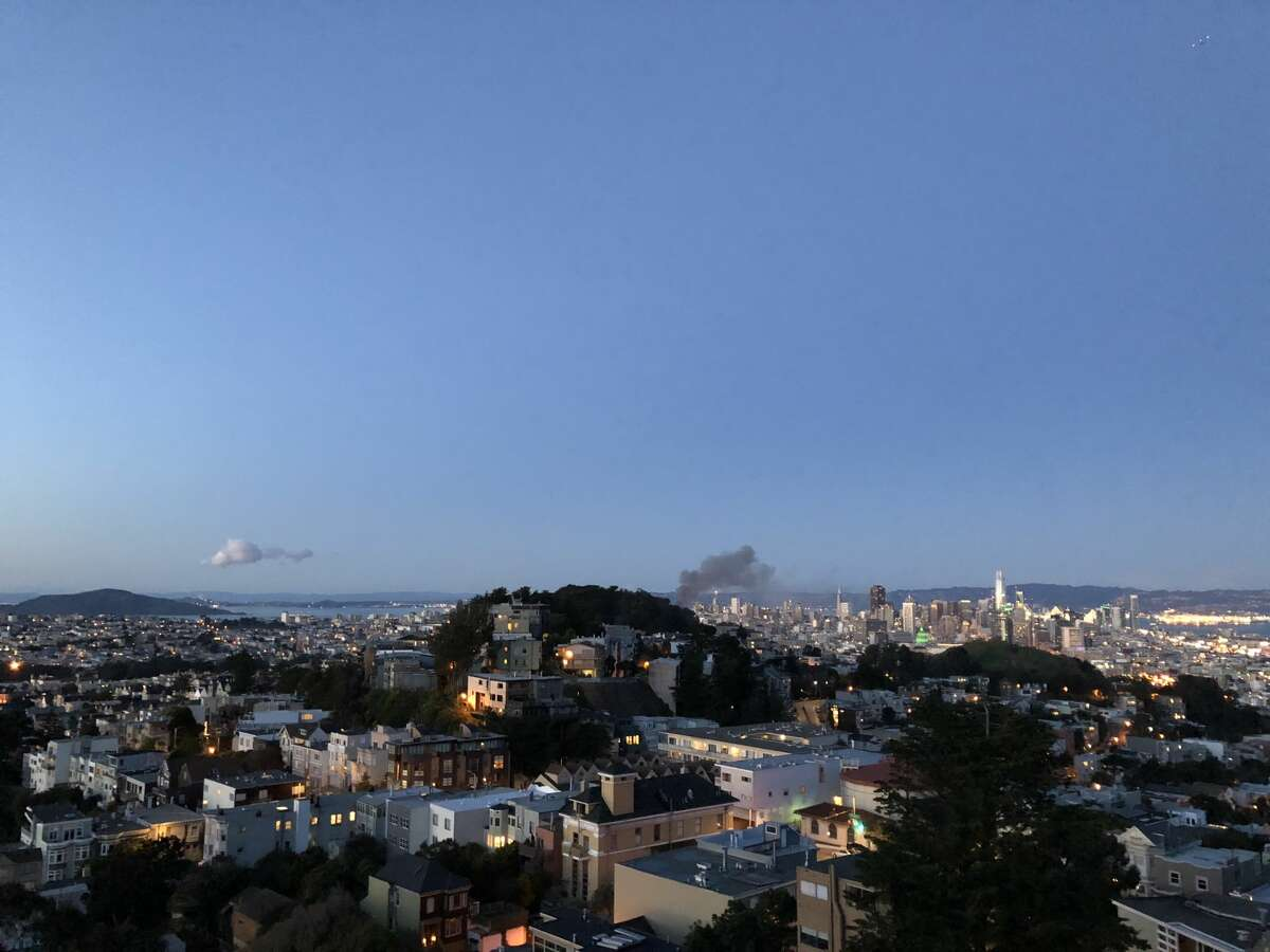 Smoke coming from a fire on Union Street in San Francisco can be seen from Tank Hill on Saturday, March 17, 2018.