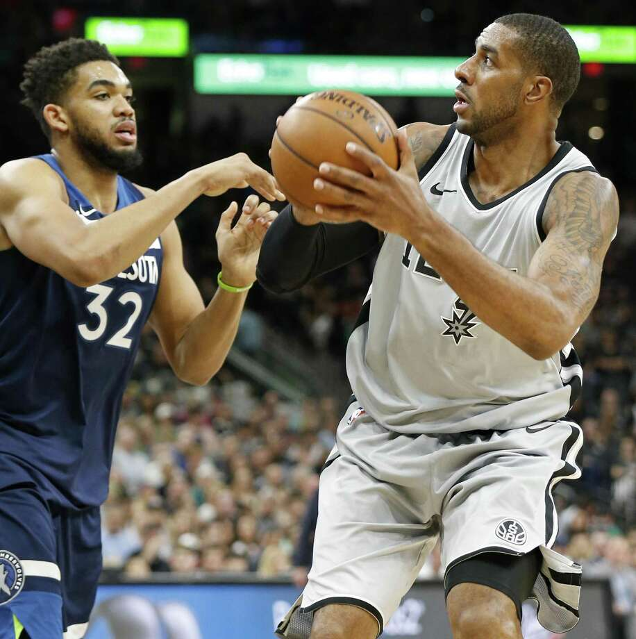 The Spurs' LaMarcus Aldridge looks for room around Minnesota's Karl-Anthony Towns during Saturday's game. Aldridge finished with 39 points and 10 rebounds as the Spurs kept their postseason hopes alive. Photo: Edward A. Ornelas / San Antonio Express-News / © 2018 San Antonio Express-News